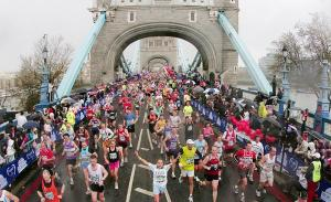 Runners cross Tower Bridge during the 2008 Flora London Marathon.